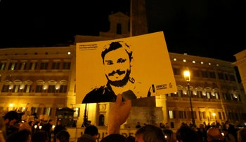 File photo: A man holds a placard during a vigil to commemorate Giulio Regeni, who was found murdered in Cairo a year ago, in downtown Rome, Italy January 25, 2017.