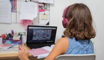 A child participates in an online lesson.