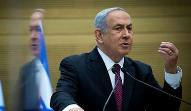Israeli Prime Minister Benjamin Netanyahu delivers a statement to his Likud party in Jerusalem, Wednesday, Dec. 2, 2020.