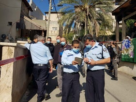 Police officers arrive at the crime scene in the Arab town of Reineh in northern Israel, December 3, 2020.