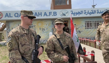 U.S. soldiers stand guard during the hand over ceremony of Qayyarah Airfield, Iraqi Security Forces, in the south of Mosul, Iraq, March 27, 2020.