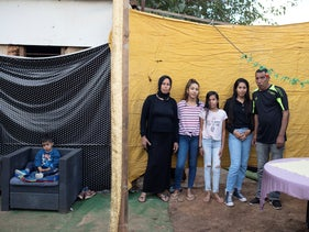 The Hasanat family outside their home in Nes Tziona, November 2020.