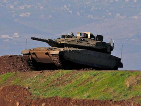 An Israeli tank holds a position in the Golan Heights on November 30, 2020.