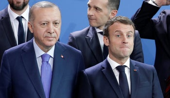 Turkey's President Recep Tayyip Erdogan, left and French President Emmanuel Macron stand, during a group photo at a conference on Libya at the chancellery in Berlin, Germany,  January 20, 2020.
