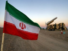 An Iranian flag is pictured near in a missile during a military drill, with the participation of Iran's Air Defense units, Iran. October 19, 2020