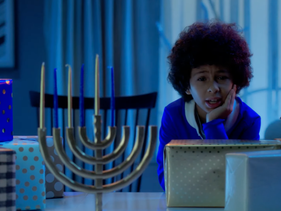 A kid hoping for a puppy as a present in Daveed Diggs' new Hanukkah song. (Screenshot from YouTube)