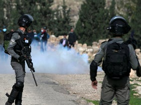 Tear gas fired by Israeli soldiers billows during a protest in Kafr Malik on December 4, 2020.