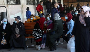 Passengers wait for their passports to be processed so they can cross the Rafah border to the Egyptian side, in Rafah, Gaza Strip, Tuesday, November 24, 2020. Egypt.