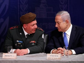 Gadi Eisenkot (L) and Benjamin Netanyahu at a ceremony appointing Aviv Kochavi as the new IDF chief of staff, January 2019.
