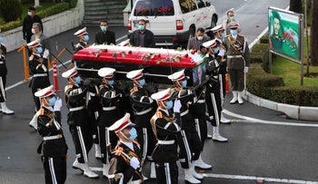 Military personnel carry the flag draped coffin of Mohsen Fakhrizadeh, a scientist who was killed on Friday, in a funeral ceremony in Tehran, Iran, Monday, November 30, 2020