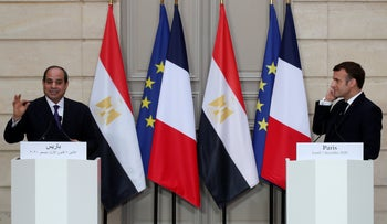 French President Macron, right, and Egyptian President el-Sissi at a press conference in Paris amid criticism from human rights groups over Egypt's crackdown on dissent, December 7, 2020