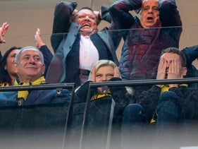 Israeli Prime Minister Benjamin Netanyahu, sitting left next his wife Sara and son Avner, and several high-ranking senior Likud members react during a Beitar Jerusalem match, Jerusalem, February 17, 2020.