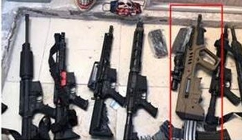 Firearms found during a raid on a Mexican drug cartel also included an Israeli Tavor rifle (in red)