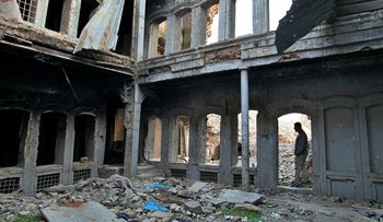 A damaged house remains un-repaired three years after Iraqi forces defeated the Islamic State group, in the Old City of Mosul, Iraq, November 29, 2020.