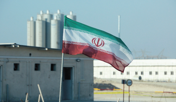In this file photo, an Iranian flag flutters in Iran's Bushehr nuclear power plant, during an official ceremony to kick-start works on a second reactor at the facility, November 10, 2019.
