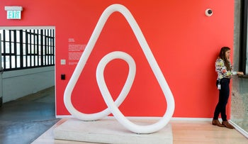 A woman talks on the phone at the Airbnb office headquarters in the SOMA district of San Francisco, California, U.S., August 2, 2016.