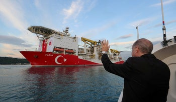 President Recep Tayyip Erdogan waves as Turkey's drilling vessel Fatih departs for the Black Sea during a ceremony in Istanbul, May 29, 2020.