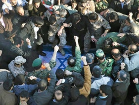 A 2015 photo of Iranians destroying an effigy of an Israeli flag during the funeral of a Revolutionary Guard officer killed during an Israeli airstrike in Syria.
