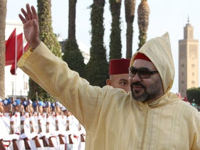 Moroccan King Mohammed VI waves to the crowd as he arrives to the the opening session in the Morocco Parliament in Rabat, in October 2018.