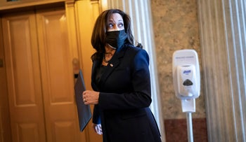 Vice President-elect Sen. Kamala Harris heads into the Senate chamber for a procedural vote on the National Defense Authorization Act, at the Capitol in Washington, December 11, 2020.