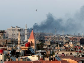 Smoke rises from heavy shelling in the Jobar neighborhood in Damascus, Syria, seen from Cairo, August 22, 2013.