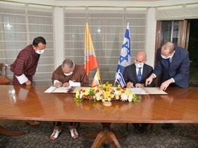 Israeli and Bhutanese officials sign an agreement establishing diplomatic relations, at the residence of Israel's Ambassador to India, New Delhi, December 12, 2020.