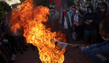Moroccans burn an Israeli flag during a protest against normalizing relations with Israel, in Rabat, Morocco, September 18, 2020.