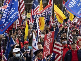 People gather in support of President Donald Trump and in protest the outcome of the 2020 presidential election at freedom plaza on December 12, 2020 in Washington, DC.