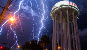 Lightning bolts strike Cocoa, Florida, amid its power lines.