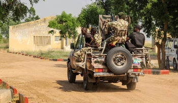 Nigerian Army soldiers are seen driving on a military vehicle in Ngamdu, Nigeria, on November 3, 2020