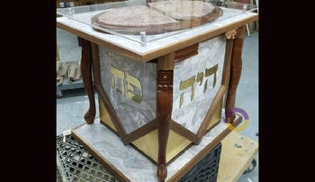 A coffee table turned defensive weapon is now a menorah stand, recalling the attack on a rabbi's home in Monsey, N.Y., last Hanukkah. (Rabbi Yisroel Kahan)