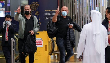 Israelis gesture as they pass passport control upon arrival from Tel Aviv to the Dubai airport in the United Arab Emirates, on November 26, 2020.