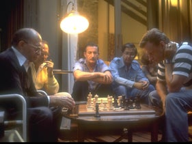 Prime Minister Menachem Begin and U.S. President Jimmy Carter's security adviser Brzezinski play a game of chess at Camp David, September 9, 1978.