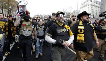 Supporters of President Donald Trump who are wearing attire associated with the Proud Boys attend a rally at Freedom Plaza, Washington, December 12, 2020.