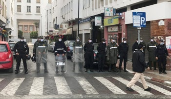 Members of security forces stand guard as authorities prevented a protest against the kingdom's move to normalize ties with Israel in Rabat, Morocco, December 14, 2020.