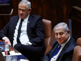 Benjamin Netanyahu (R) and Benny Gantz during a swearing-in ceremony of the new government in Jerusalem, May 17, 2020.