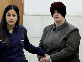 Australian Malka Leifer, right, is brought to a courtroom in Jerusalem, 2018.