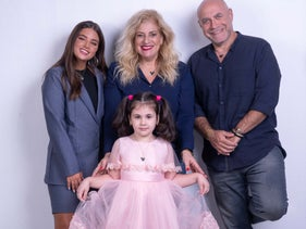 Wish Israel co-founder and CEO Denise Bar-Aharon (center) and superstars Noa Kirel and Dvir Benedek with wish child Eva modeling the new Make-A-Wish Mickey Mouse necklace.