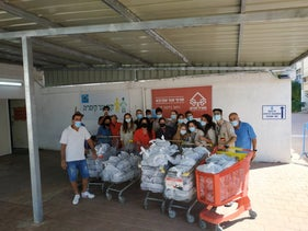 Members of the Israeli Scouts and other volunteers help Meir Panim collect and distribute food to the needy.