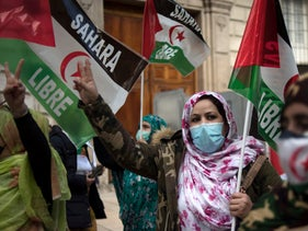 People take part in a demonstration in support of the Sahrawi people's rights in Malaga, Spain on November 28, 2020.