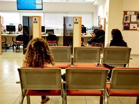 People wait at a branch of Israel's Employment Service, 2018.