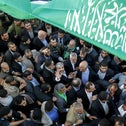 Hamas leader Khaled Meshaal visits Gaza from exile in a homecoming parade together with Hamas prime minister Ismail Haniyeh (C-R). Gaza City, December 7, 2012