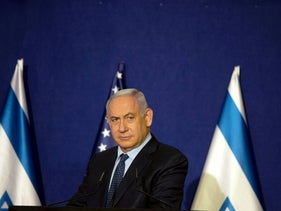 Israeli Prime Minister Benjamin Netanyahu listens during a joint statement with U.S. Secretary of State Mike Pompeo in Jerusalem, November 19, 2020