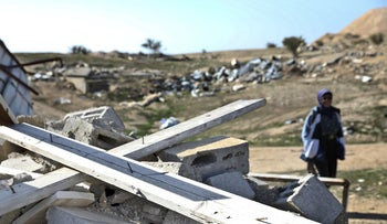 A resident of the Bedouin village walking past a demolished structure in Umm al-Hiran, in the Negev.