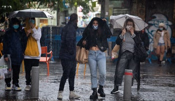 People wear masks to protect against the coronavirus in Tel Aviv, December 16, 2020.