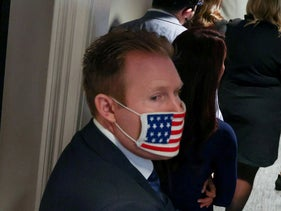 Andrew Giuliani attends a news conference with his father at the Republican National Committee headquarters in Washington, November 19, 2020.