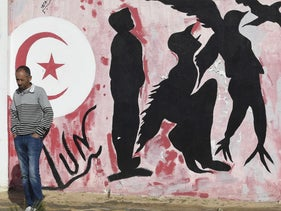 graffiti depicting silhouettes of a man metamorphosing into a bird symbolising freedom, in Mohamed Bouazizi Square in the centre of the town of Sidi Bouzid in central Tunisia on October 27, 2020