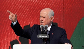 Nationalist Movement Party (MHP) leader Devlet Bahceli delivers a speech during a protest against the 