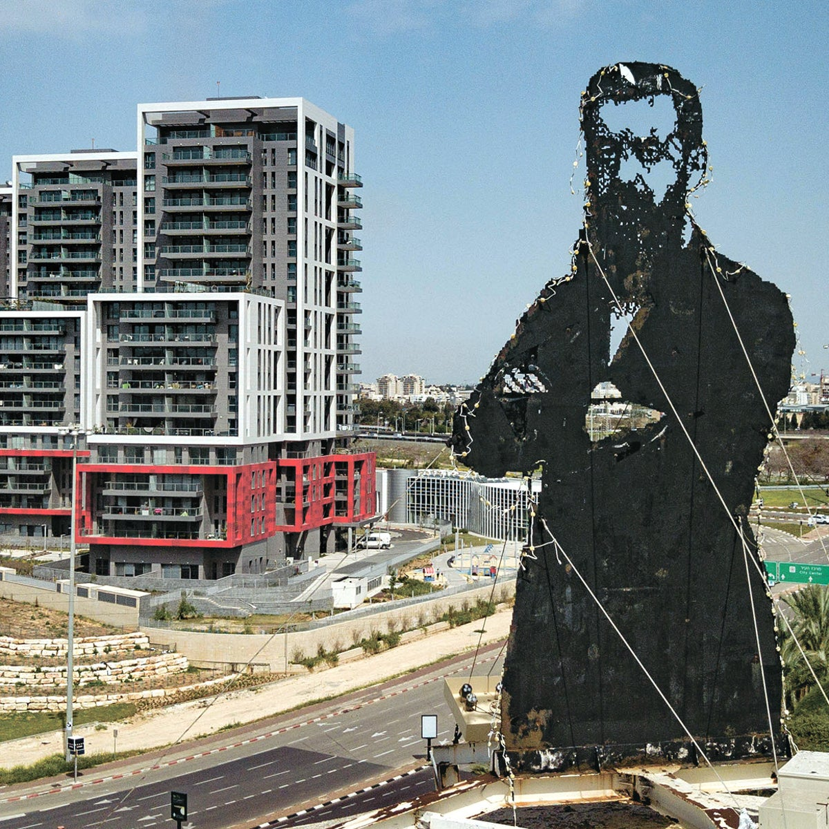 The figure of Theodor Herzl, dominating the landscape of the Israeli coastal city named for him.