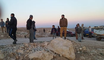 Settlers and Palestinians near the village of Safai in the South Hebron Hills.